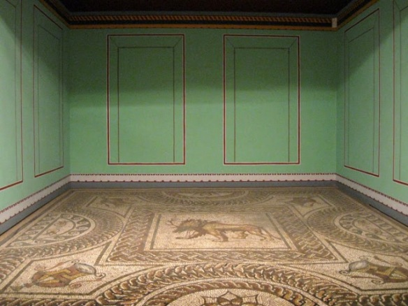 Reconstruction of what would have been a dining room in a Roman villa. The floor would have been a mosaic on which couches would have been placed for the family to have their wine and grapes :-)