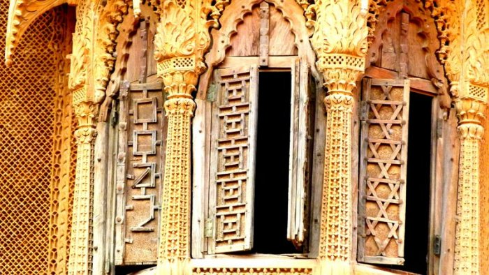 Carved stonework and carved windows. I can't decide which one is more beautifulc