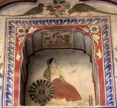 A woman spinning the charkha (Bhagaton ki Haveli)