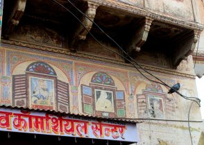 Quirky fresco painted over a shop front in the Nawalgarh Market